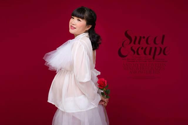 甘薇也忍喜欢晒 双胞胎儿子的范玮琪,在孕期的时候,她的 孕肚也十分明